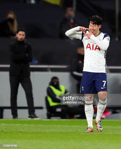 Arsenal's Spanish manager Mikel Arteta watches as Tottenham Hotspur's South Korean striker Son Heung-Min celebrates scoring the opening goal during...