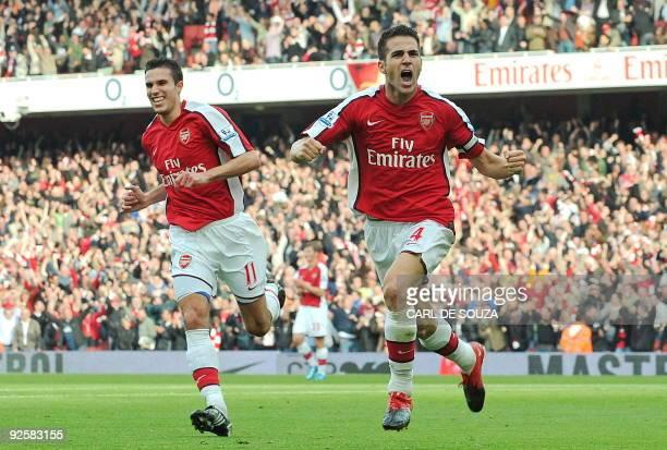 Arsenal's Spanish midfielder Cesc Fabregas and Dutch forward Robin van Persie celebrate Fabregas' goal during the English Premier League football...
