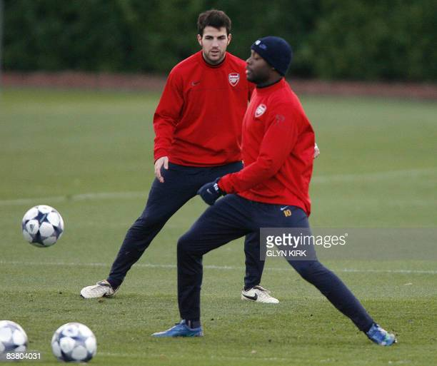 Arsenal's Spanish Midfielder Cesc Fabregas and French Defender William Gallas attend a team training session at London Colney, north of London, on...