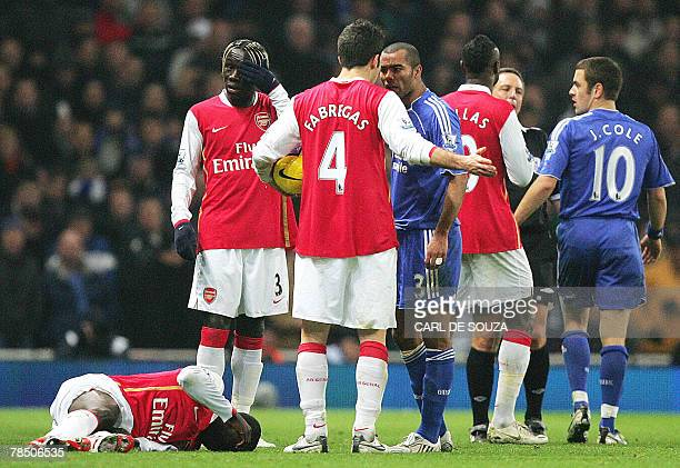 Arsenal's Spanish midfielder Cesc Fabregas argues with Chelsea's English defender Ashley Cole after his tackle on Arsenal's Ivory Coast defender...