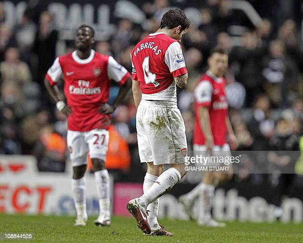 Arsenal's Spanish midfielder Cesc Fabregas leaves the pitch after his team lose a four goal lead to draw against Newcastle United in the English...