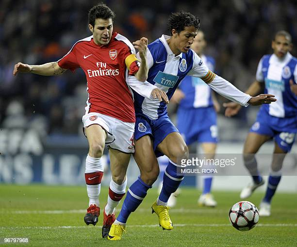 Arsenal's Spanish midfielder Cesc Fabregas vies with FC Porto's defender Bruno Alves during their UEFA Champions League football match at the Dragao...