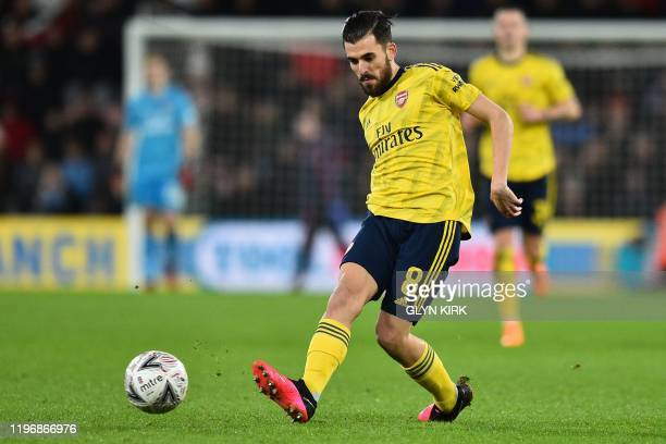 Arsenal's Spanish midfielder Dani Ceballos passes the ball during the English FA Cup fourth round football match between Bournemouth and Arsenal at...