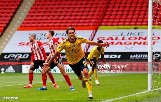 Arsenal's Spanish midfielder Dani Ceballos runs to celebrate scoring a goal during the English FA Cup quarter-final football match between Sheffield...
