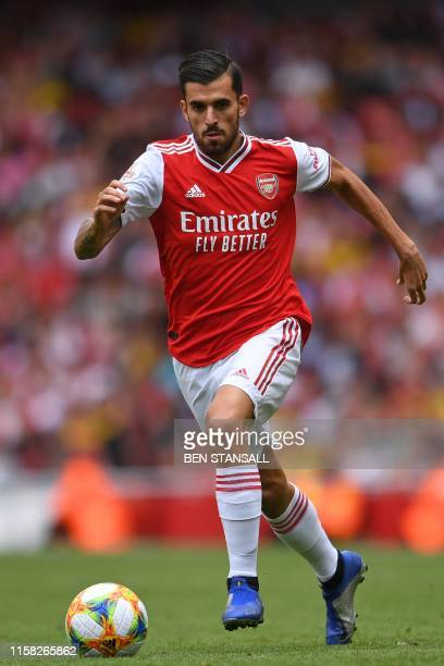 Arsenal's Spanish midfielder Dani Ceballos runs with the ball on his debut during the pre-season friendly football match for the Emirates Cup between...