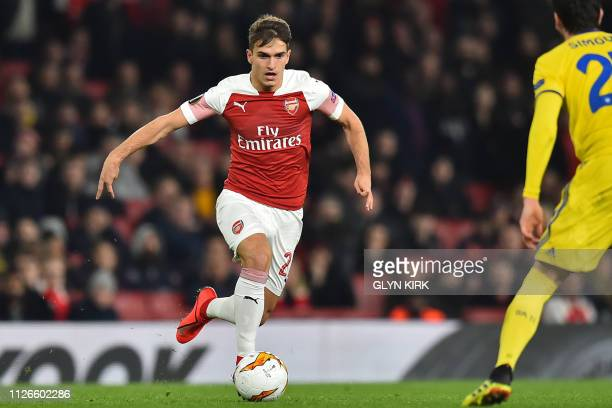 Arsenal's Spanish midfielder Denis Suarez runs with the ball during the UEFA Europa League round of 32 2nd leg football match between Arsenal and...