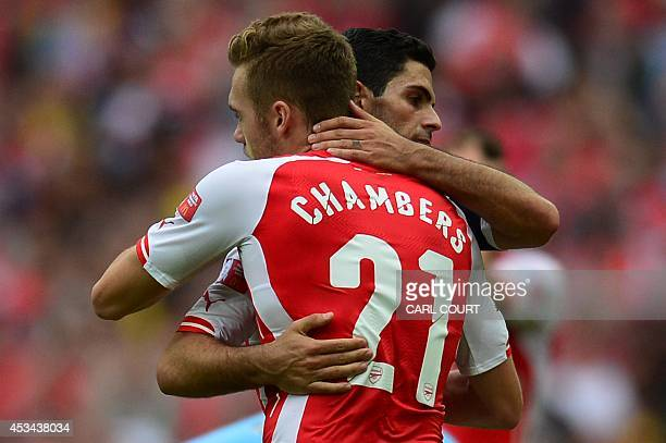 Arsenal's Spanish midfielder Mikel Arteta embraces Arsenal's English defender Calum Chambers at the final whistle after Arsenal won the FA Community...