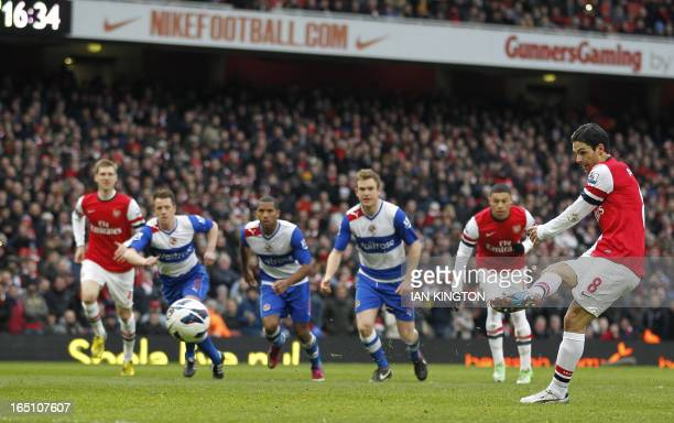 Arsenal's Spanish midfielder Mikel Arteta scores their fourth goal from the penalty spot during the English Premier League football match between...