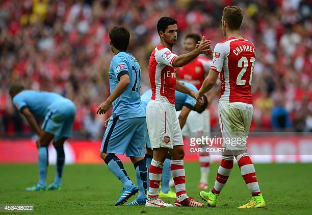 Arsenal's Spanish midfielder Mikel Arteta shakes hands with Arsenal's English defender Calum Chambers at the final whistle after Arsenal won the FA...