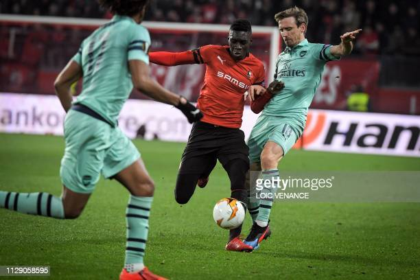 Arsenal's Spanish midfielder Nacho Monreal vies with Rennes' Senegalese forward Ismaila Sarr during the UEFA Europa League round of 16 first leg...