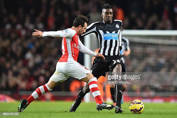 Arsenal's Spanish midfielder Santi Cazorla battles with Newcastle United's English striker Sammy Ameobi during the English Premier League football...