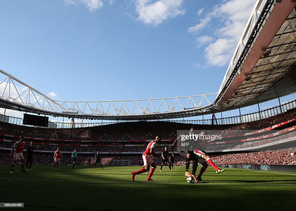 Arsenal's Spanish midfielder Santi Cazorla (R) challenges Liverpool's Senegalese midfielder Sadio Mane (2R) during the English Premier League football match between Arsenal and Liverpool at the Emirates Stadium in London on August 14, 2016. / AFP / Lee MILLS / RESTRICTED TO EDITORIAL USE. No use with unauthorized audio, video, data, fixture lists, club/league logos or 'live' services. Online in-match use limited to 75 images, no video emulation. No use in betting, games or single club/league/player publications. /