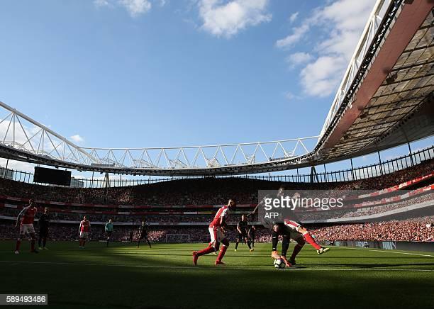 Arsenal's Spanish midfielder Santi Cazorla challenges Liverpool's Senegalese midfielder Sadio Mane during the English Premier League football match...