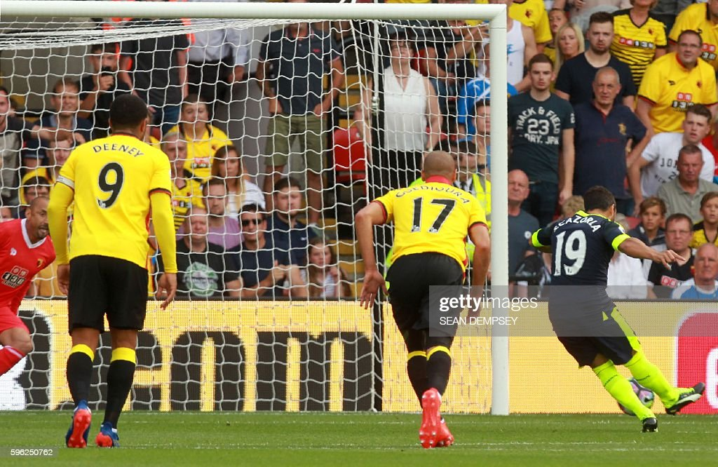 Arsenal's Spanish midfielder Santi Cazorla (R) scores the opening goal from the penalty spot during the English Premier League football match between Watford and Arsenal at Vicarage Road Stadium in Watford, north of London on August 27, 2016. / AFP / Sean Dempsey / RESTRICTED TO EDITORIAL USE. No use with unauthorized audio, video, data, fixture lists, club/league logos or 'live' services. Online in-match use limited to 75 images, no video emulation. No use in betting, games or single club/league/player publications. /
