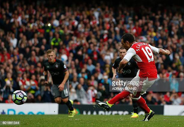Arsenal's Spanish midfielder Santi Cazorla scores the winning goal from the penalty spot during the English Premier League football match between...