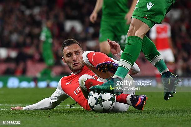 Arsenal's Spanish striker Lucas Perez vies with Ludogorets' Brazilian defender Natanael Batista Pimienta during the UEFA Champions League Group A...