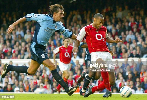 Arsenal's striker Thierry Henry scores the first goal of the match at Highbury in London 30 October 2004 during Barclays premiership football match...