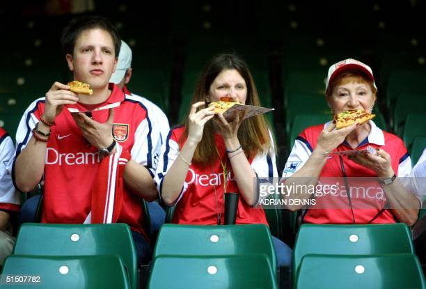 Arsenal's supporters enjoy a slice of pizza while waiting for the kickoff between Arsenal and Liverpool in the FA Cup final at The Millennium Stadium...