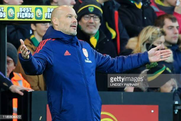 Arsenal's Swedish Interim head coach Freddie Ljungberg gestures on the touchline during the English Premier League football match between Norwich...