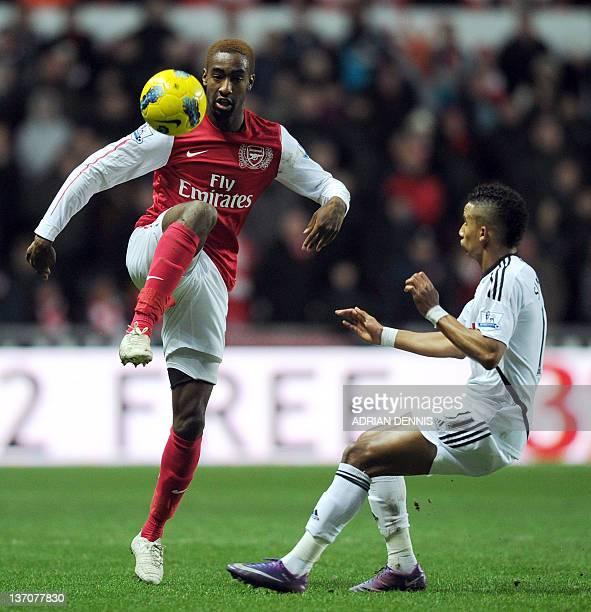 Arsenal's Swiss defender Johan Djourou vies with Swansea City's Scott Sinclair during their English Premiership football match at the Liberty Stadium...