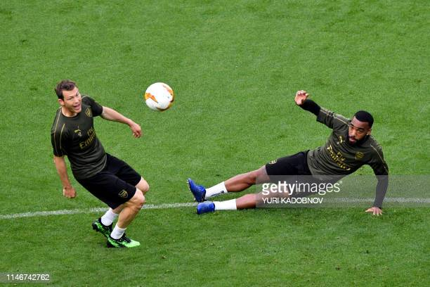 Arsenal's Swiss defender Stephan Lichtsteiner and Arsenal's French striker Alexandre Lacazette attend a training session at the Baku Olympic Stadium...