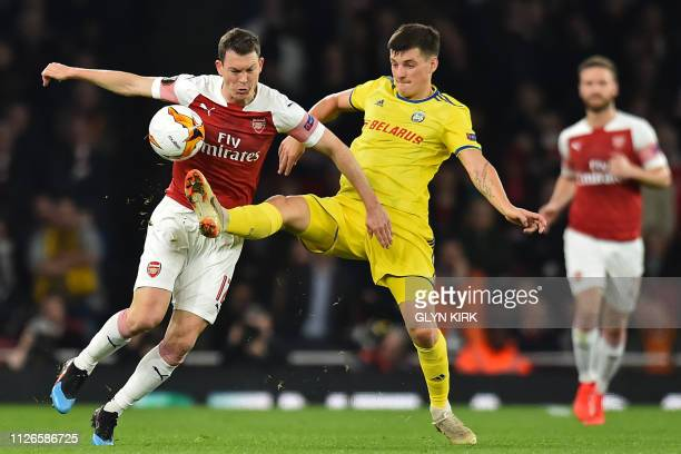 Arsenal's Swiss defender Stephan Lichtsteiner vies with BATE Borisov's Belarusian midfielder Stanislav Dragun during the UEFA Europa League round of...