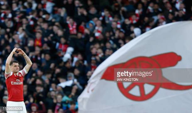 Arsenal's Swiss midfielder Granit Xhaka celebrates scoring the opening goal during the English Premier League football match between Arsenal and...