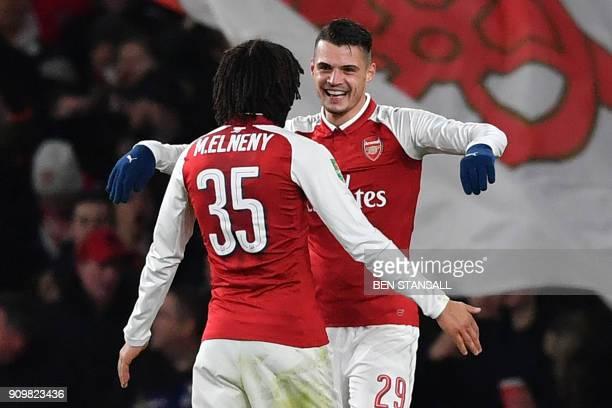 Arsenal's Swiss midfielder Granit Xhaka celebrates scoring the team's second goal with Arsenal's Egyptian midfielder Mohamed Elneny during the League...