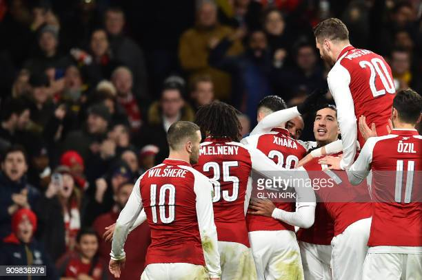Arsenal's Swiss midfielder Granit Xhaka celebrates scoring the team's second goal with teammates during the League Cup semifinal football match...