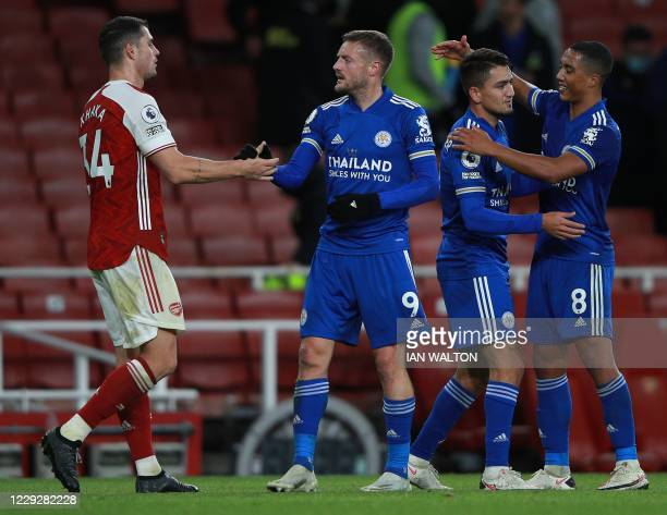 Arsenal's Swiss midfielder Granit Xhaka congratulates Leicester City's English striker Jamie Vardy at the final whistle during the English Premier...