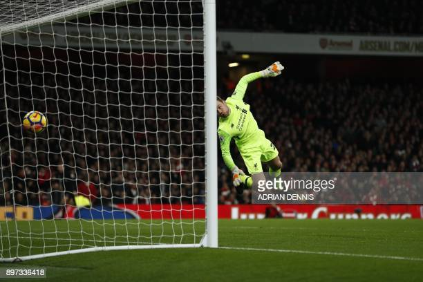 Arsenal's Swiss midfielder Granit Xhaka scores past Liverpool's Belgian goalkeeper Simon Mignolet during the English Premier League football match...