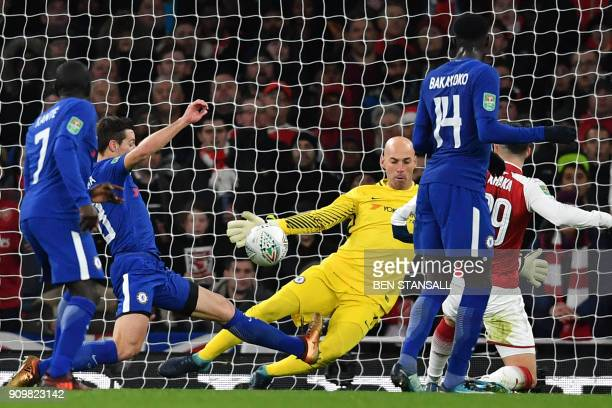 Arsenal's Swiss midfielder Granit Xhaka scores the team's goal past Chelsea's Argentinian goalkeeper Willy Caballero during the League Cup semifinal...
