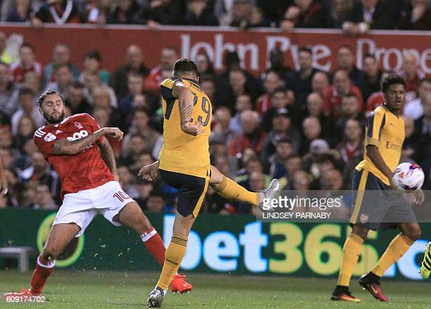 Arsenal's Swiss midfielder Granit Xhaka shoots to score the opening goal of the English League Cup third round football match between Nottingham...