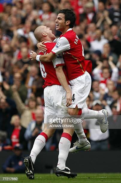 Arsenal's Swiss player Philippe Senderos celebrates after he scored alongside Cesc Fabregas against Sunderland player during the Premiership football...