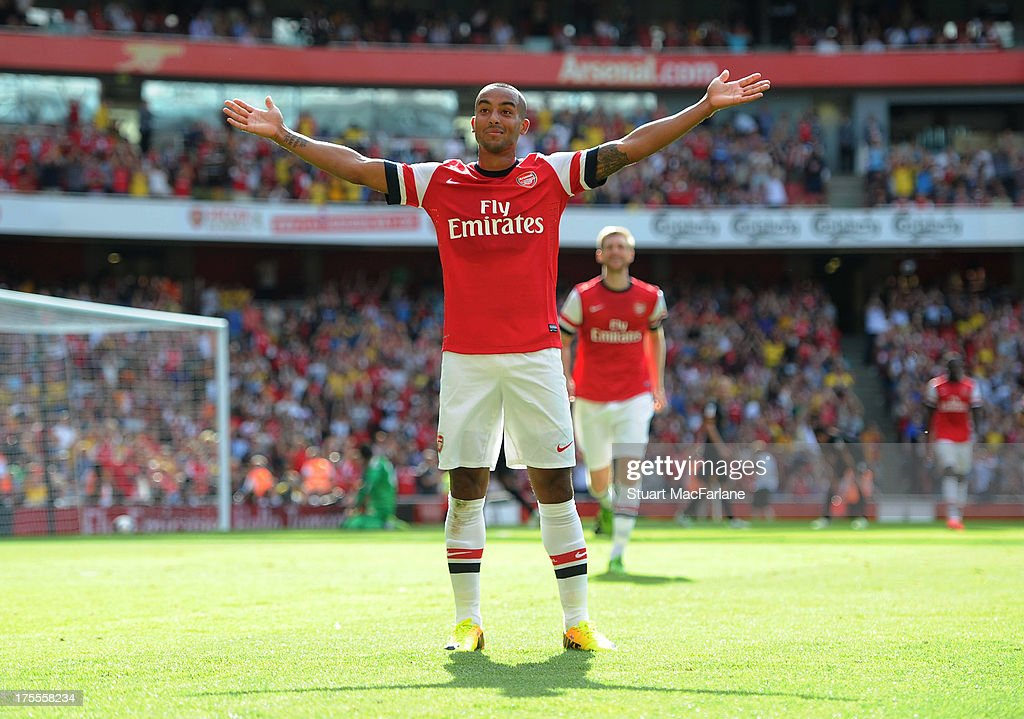Arsenal's Theo Walcott celebrates his goal during the Emirates Cup match between Arsenal and Galatasaray at the Emirates Stadium on August 04, 2013 in London, England.