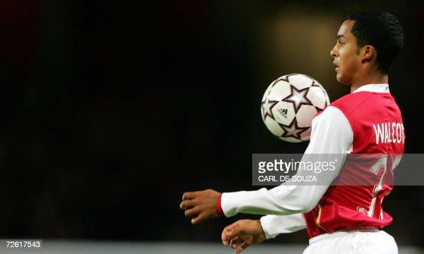 Arsenal's Theo Walcott controls the ball during their UEFA Champions League Group G soccer match against Hamburg SV at home to Arsenal, 21 November...