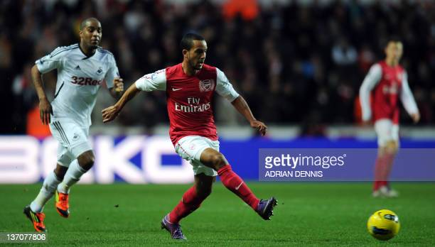 Arsenal's Theo Walcott makess a pass against Swansea City during their English Premiership football match at the Liberty Stadium in Swansea on...
