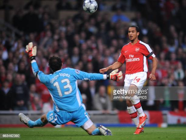 Arsenal's Theo Walcott scores the first goal past Villarreal's goalkeeper Diego Lopez