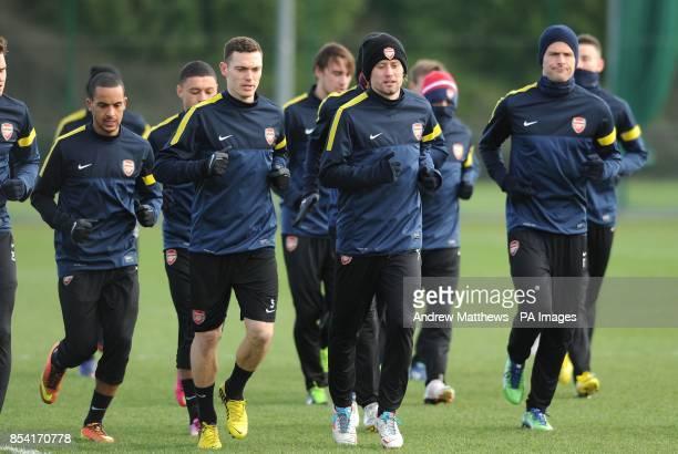 Arsenal's Theo Walcott Thomas Vermaelen Tomas Rosicky and Olivier Giroud during the training session at London Colney Training Ground Hertfordshire