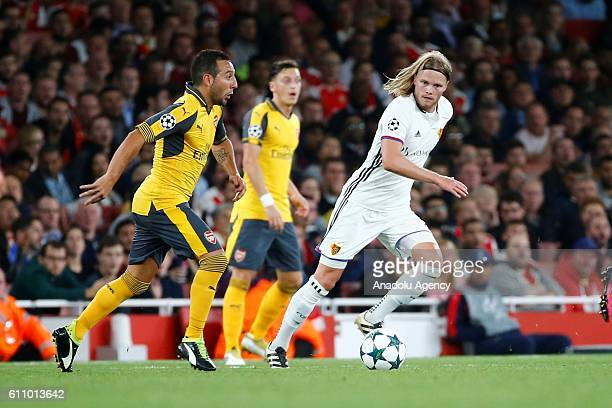 Arsenals Theo Walcott vies with Basel's Birkir Bjarnason during Champions League Group A match between Arsenal FC and FC Basel at Emirates Stadium on...