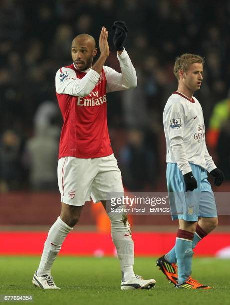 Arsenal's Thierry Henry applauds to the fans as Aston Villa's Barry Bannan walks off dejected