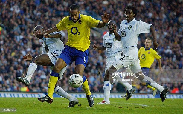 Arsenal's Thierry Henry beats Leeds defenders Salomon Olembe and Jose Roque during today's premiereship clash at Elland Road Leeds 01 November 2003...