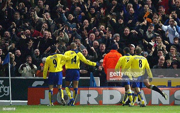 Arsenal's Thierry Henry celebrates with fans and fellow players after scoring against Portsmouth during their FA Cup Quarter Final football match in...
