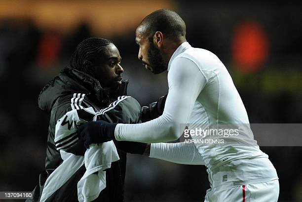 Arsenal's Thierry Henry congratulaes Swansea City's Nathan Dyer during their English Premiership football match at the Liberty Stadium in Swansea on...