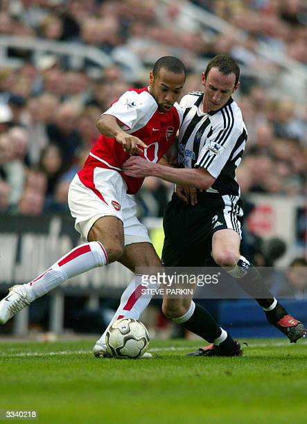 Arsenal's Thierry Henry duels Newcastle's Andy Obrien during their football match 11 April 2004 in Newcastle AFP PHOTO/STEVE PARKIN