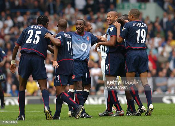 Arsenal's Thierry Henry is congratulated by teamates after scoring Arsenals third goal ag Leeds during their Premiership clash 28 September 2002 at...