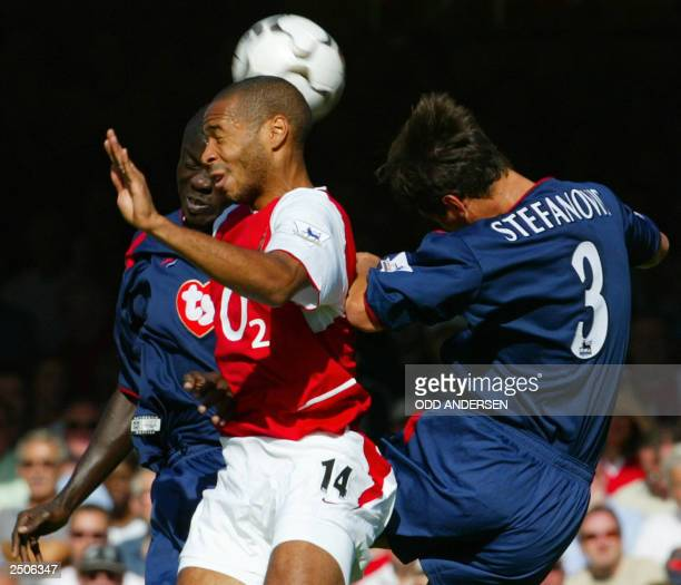 Arsenal's Thierry Henry jumps for a head ball along with Portsmouth's Amdy Faye and Dejan Stepanovic 13 September, 2003 at Highbury Stadium in...