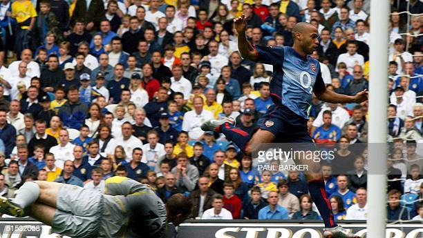 Arsenal's Thierry Henry steps over Leeds keeper Paul Robinson to score Arsenals third goal during their Premiership clash 28 September 2002 at Elland...