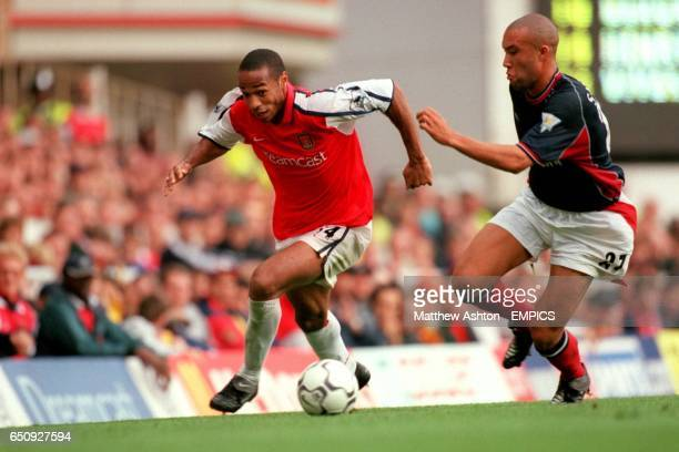 Arsenal's Thierry Henry takes on Manchester United's Mickael Silvestre