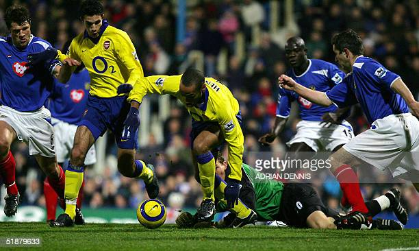 Arsenal's Thierry Henry tries to take the ball past Portsmouth's goalkeeper Jamie Ashdown in a goalmouth scramble during the Premiership match at...